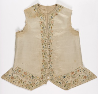 Man's white waistcoat embroidered with polychrome silks in a floral design. Blue and yellow are especially bright.