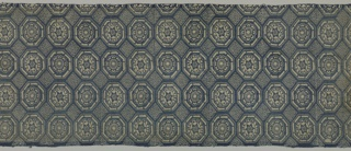 Traditional all-over geometric design of octagons framing rosettes, and tilted squares, in dark blue and white.