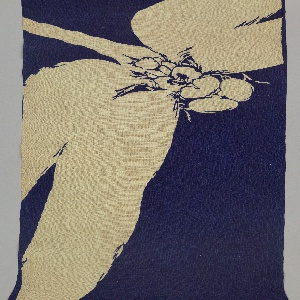Kimono fabric with large-scale dragon flies reserved in white and placed at angles across a dark blue ground fabric. Dragon flies appeared cropped at the wings due to the large scale.