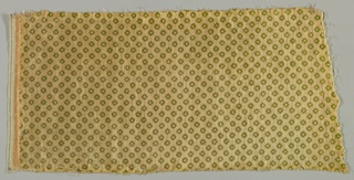 A small diamond pattern printed in green on the tan/gold cut pile of the velvet.