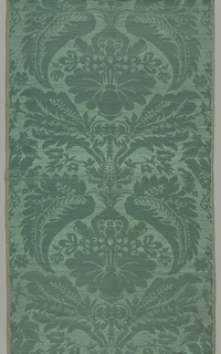 Length of green satin in a pattern of large-scale flowers repeated vertically within ogives formed by curving leaves. Each unit fills the fabric from selvage to selvage. Designed and manufactured in the style of the early eighteenth century.