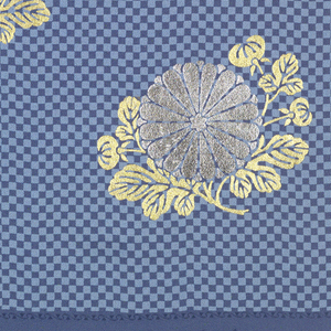 Background of small-scale checks in light and medium blue for widely-spaced chrysanthemums in gold and silver. Signatures at one end.
