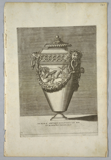 "Vertical rectangle. Covered urn with handles composed of lions' heads. In the center of the body, a garland above which is a striding lion on a branch. Inscribed below: ""SIC ROMAE ANTIQVI SCULPTORES EX AERE / ET MARMORE FACIEBANT."""