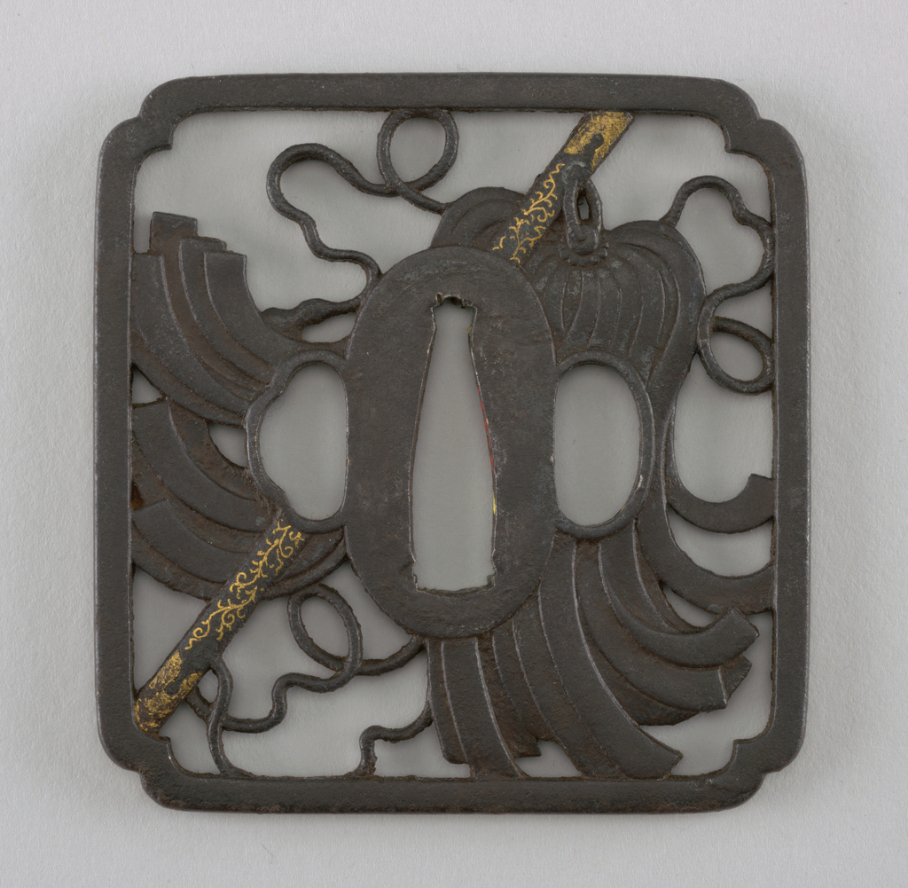 This iron tsuba is kaku mokkō (square with lobed corners) in shape and has a kaku mimi (square outer rim). Marubori-Sukashi  (round openwork carving) shows a design with a military baton decorated with kin hira zogan (flat gold inlay)    At the center is the nakago-ana, an opening through which the sword passes. Surrounding this is the seppadai, a flat oval area that is migaki (burnished). The outer rim is round, or maru-mimi. On either side are ryō-hitsu, openings for the kozuka (utility knife) and the kogai (skewer tool). At right is sashi ura, the side which faces the blade, whose opening takes the hangetsu-kei (half moon) shape. Opposite is sashi omote, the side which faces the sword hilt. Its tri-lobed opening is of the suhama type, and symbolically represents the coastline of Horai, the holy island of the Immortals.