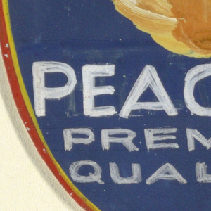 Product label in oval shape, with blue background, large peach, and white lettering.