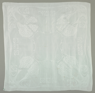 Austria/Scotland Art-style napkin. Stylized tree forms extend inward from each corner toward a lobed square in the center. Compartmentalized geometric and organic forms fill spaces between the tree motifs. White monogram embroidered in the corner.