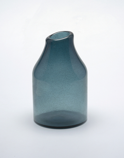 Blue/turquoise glass.  small airbubbles in surface of glass