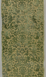 Vase and scroll pattern in green on cream.
