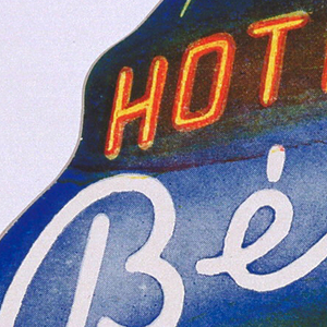"""""""Hotel Beke Budapest"""" in neon style script on blue globe. Latitude and longitude lines delineated in white."""