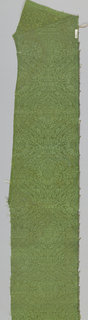 Narrow green damask in a medium-scale pattern of rising ogives fitted together. All interspaces are filled with a diaper pattern and scrolling leaves. One selvage present.