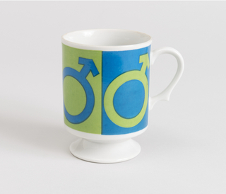 Two ceramic coffee mugs showing symbols: Male/Female
