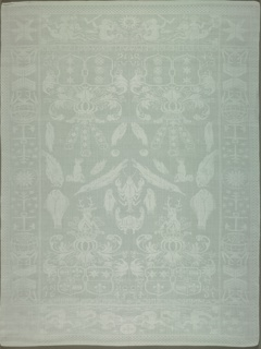White damask napkin has a vertically symmetrical field filled with crab, seal and various fish plus the coat of arms of the parents of Grovestins and Camminga. Side borders have a series of nautical symbols. Bottom border has mermaids, fish and the moon. Top border has mermaids, mermen and the sun.   Lucia Van Grovestins married Taco Van Camminga in 1638. Their names in the inscription is followed by the maiden name of each of their mothers.