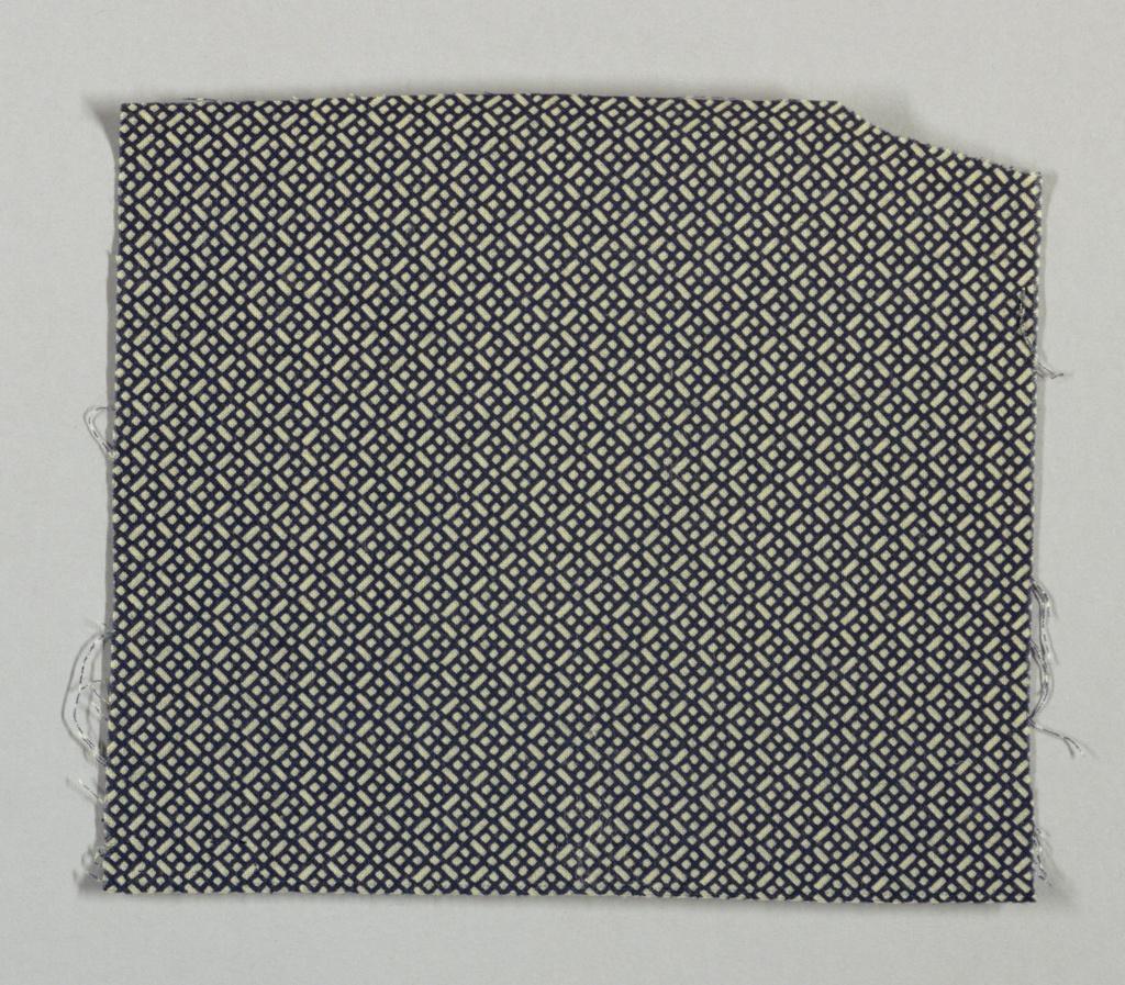 Small-scale diagonal lattice design in reserve on a dark blue ground.