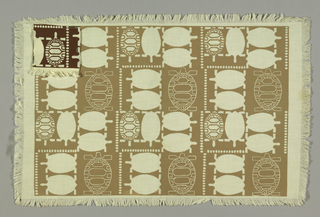 Stylized design of turtles seen from above, reserved in cream on dark beige ground. Narrow cream border left around edge and self fringe.
