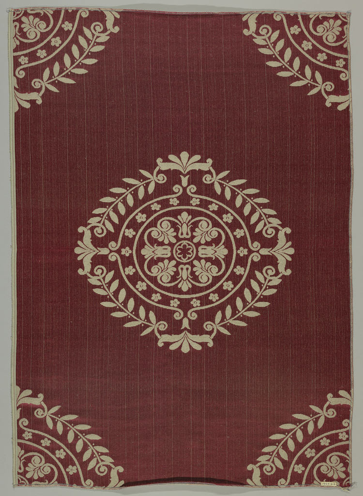 Sample in a design of large medallions composed of palmettes, rosettes, and lotus branches in the Empire style reserved in grey on a dark red satin ground. Designed and manufactured for the American Embassy in Paris.