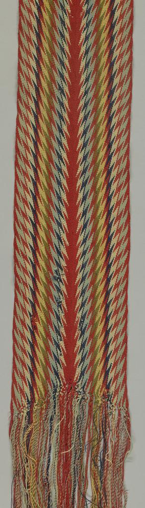 Long sash in chevon pattern, known as 'ceinture flêche'.