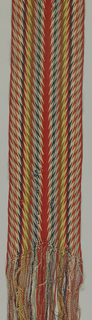 Long sash in chevon pattern, known as 'ceinture flêche'.