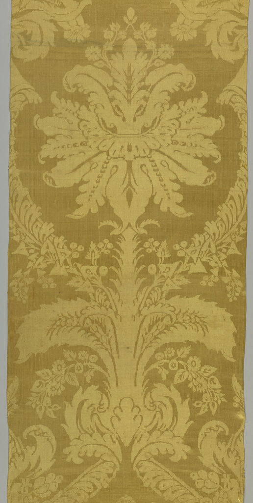 Two long narrow panels of dull gold damask, large stylized symmetrical repeat of scrolling leaves and flowers. No selvages present, was probably woven on wide power loom, then cut.