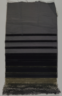 Black dress fabric that starts at the top with no pile and then adds horizontal stripes of velvet that gradually turn to grey/tan and the pile becomes longer at the bottom.
