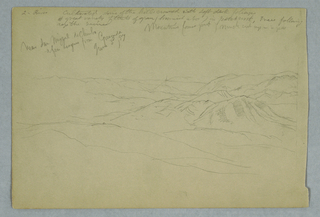 Horizontal view of hills and mountain ranges across a valley
