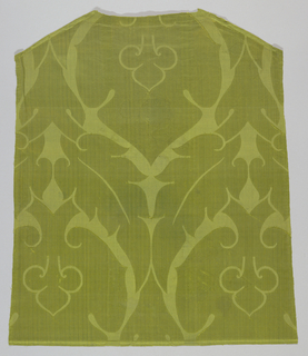 Yellow-green damask with a large-scale symmetrical abstract pomegranate shape enclosing a single fleur-de-lys. Height of repeat was probably about 24 inches.