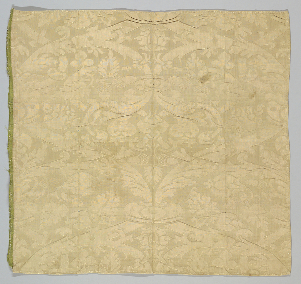 One rose-tan repeat of a symmetrical pattern (mirror image on the center line) of superimposed ogee trellis with leaves, fruit and acorns.