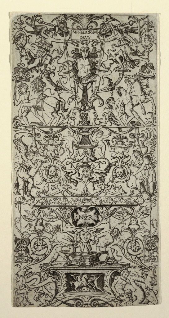 Vertical rectangle fully decorated with symmetrical grotesque. At top, cameo profiles and horses. Below, a small battle frieze and a pair of bound prisoners.