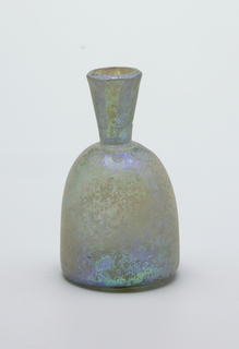 Vessel of bulbous form with flared neck. Light Green glass; iridized blue cast