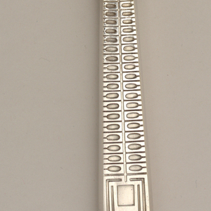 Straight blade, front of rectangular handle with engraved double row of horizontal oval forms ending in square with double outline. Reverse of handle with stylized outline and rectangle.
