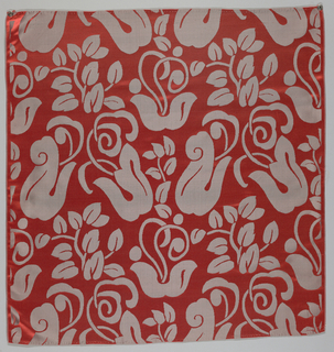 Red silk damask with a large-scale conventionalized leaf deign in gray.