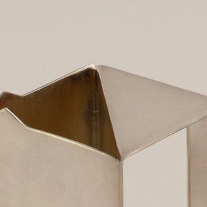Milk jug in a geometric style.  Part of a six piece tea service.  The tea service relies on pure geometric form and highly reflective surfaces for its effect.
