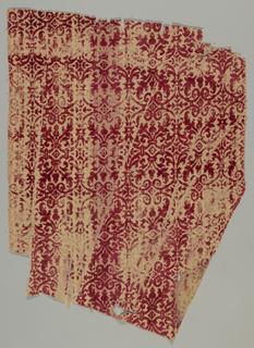 Crimson pattern in cut velvet on red and white silk weave.