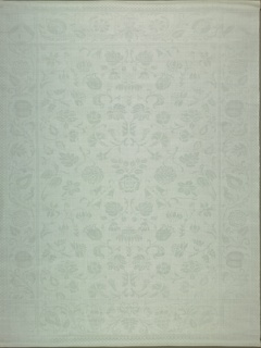 White damask napkin has a field of symmetrically repeating flowers with a floral vine border and a coat of arms in each corner.