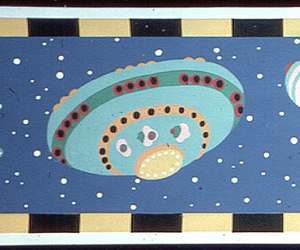 Children's frieze containing four flying space ships. Printed in colors on dark blue ground.