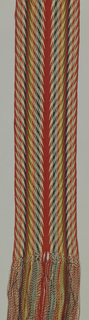 Long and narrow sash with fringes at each end with pattern of chevrins. known as 'ceinture flêche'.
