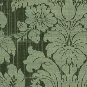 Symmetrical design of flowering plant and leaf scrolls in green. Fabric woven as a sample as there is a header top and bottom.