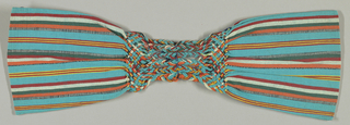 Ribbed turquoise cloth with bands of narrow stripes in orange, white, red, dark green, red and white. Pockets jointed across middle by plaited warp area. Warps at other end form thick buttonhole loops with striped cord.