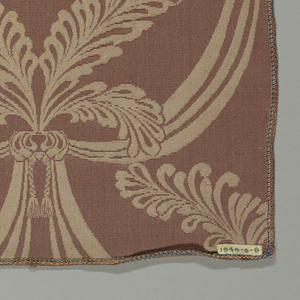 Sample in a dusty rose color has a pattern of drapery swags tied with tasseled cords and topped with large feathers
