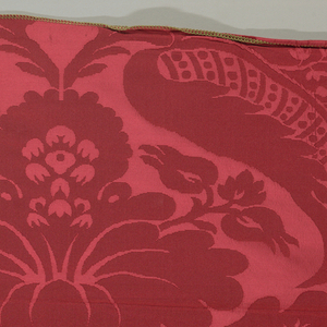 Symmetrical design of flowers and large curving leaves in bright red.