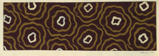 Design features a brown ground with a pattern of wavy concentric circles in ochre and white.