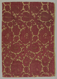 Velvet fragment has a yellow ground with a large-scale floral pattern in red cut and uncut pile.