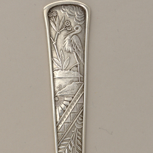 Luncheon or tea knife with plain blade; handle decorated with plant forms and animals, including a crane in a landscape.