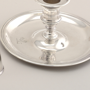 Short silver candle holder with tray, thumb loop handle and conical snuffer with bead finial.