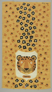 "Spots and head of a leopard, with ""Smile"" under head. Printed paper tag with ""Belgian Linen"" glued to the front."