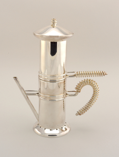 Cylindrical coffee pot with a flared top and lid. The lid has a small round knob and the coffeepot has three handles. The lowest coming off the coffeepot at the bottom right diagonally. The second coming off the left side, turning downward, with metal wire wrapped around the outside. The third right above the second, coming straight off the middle, with metal wire wrapped around the outside.