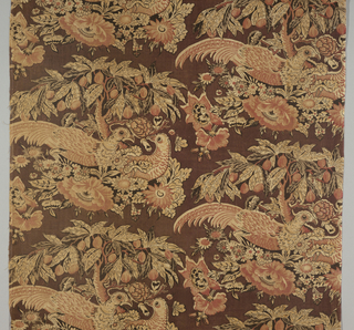 Heavy cotton with a design of pheasants under a fruit tree. Ground is a dark brownish-red with foliage, birds and fruit in red and light brown. Details and outlines in black.