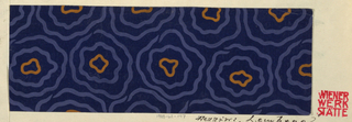 Design features a navy blue ground with pattern of wavy concentric circles in blue and gold.