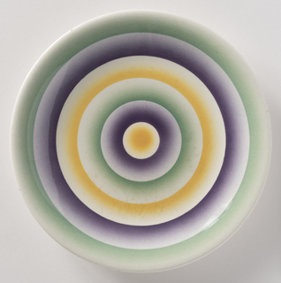 Round with concentric circles of green, purple and yellow.