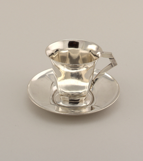 Teacup with flared rim and square bottom with angular handle