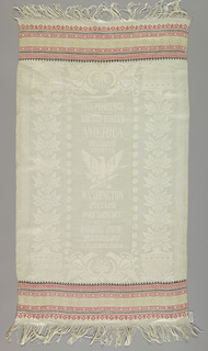 Towel with patriotic motifs and statements in white linen. Brocaded bands of pattern in red, cream and black at both ends.